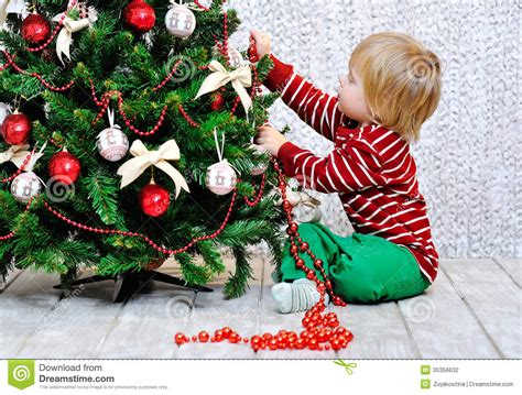 toddler decorating christmas tree stock photo image