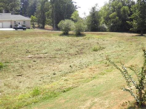 retention pond in backyard metro atlanta bobcat excavation and land clearing a