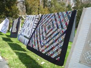amish quilts on a line in lancaster pa amish quilts