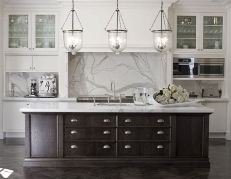 lighting over island black and white kitchen marble benches and splash back
