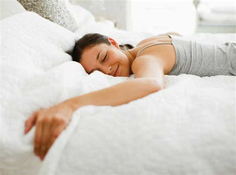 woman in bed the case for sleeping in separate beds is compelling but