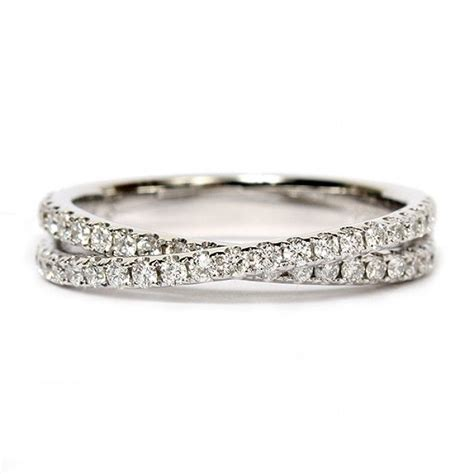 this artfully crafted 14k white gold wedding band by