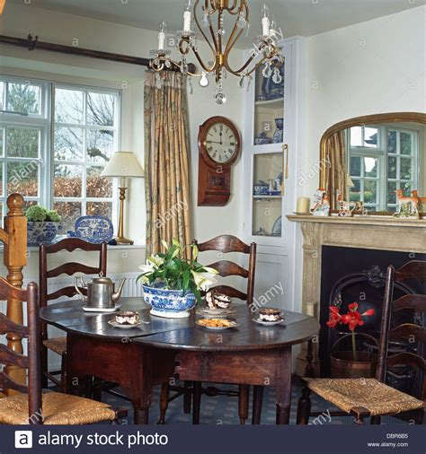 dining table in front of fireplace rush seated ladder back chairs and antique oak table in fr