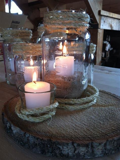 wedding centerpieces with candles and sand rustic jar centerpieces sand candles rope and tree cookies the wedding