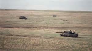 This file photo shows canadian military leopard c2 tanks cross a field
