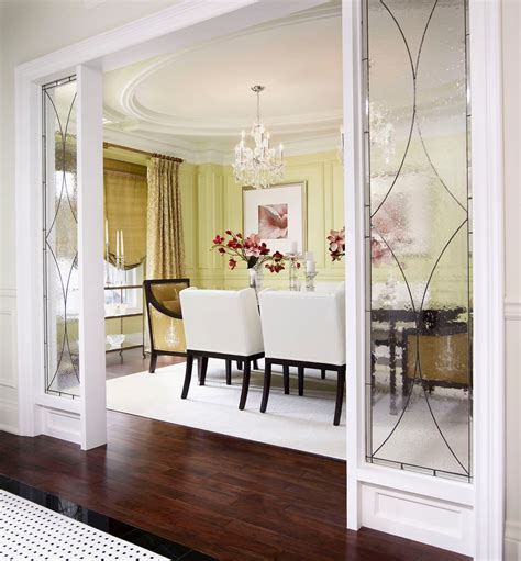 Unicab Home Design Inc | glass room divider dining room traditional with area rug