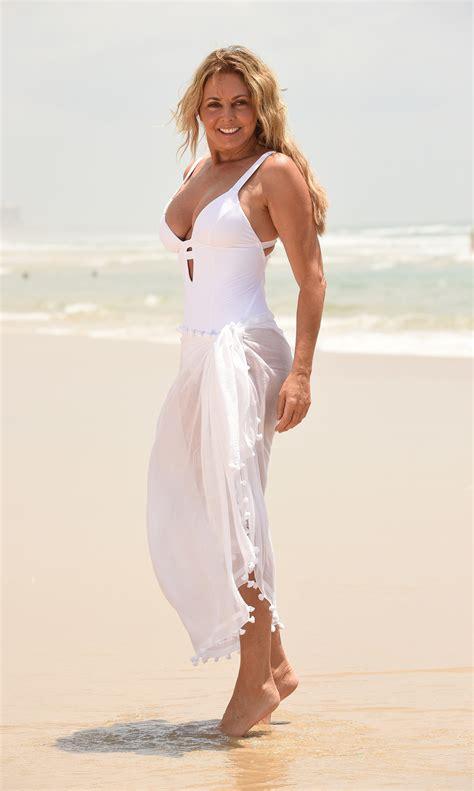 carol vorderman enjoys long walks   beach
