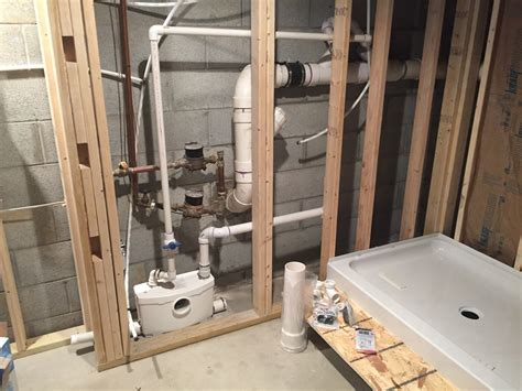 putting a bathroom in a basement saniflo bathroom with behind wall macerator creative
