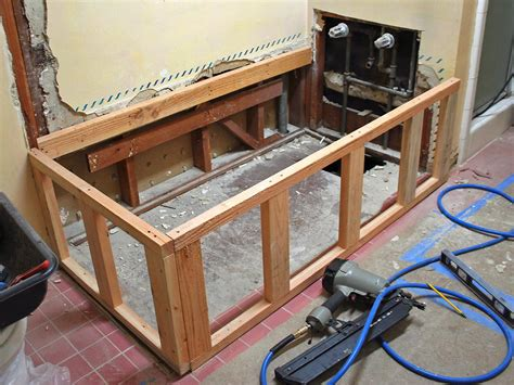 How To Build A Frame Around A Bathroom Mirror Replacing A Bathtub With A Deck Tub Hgtv