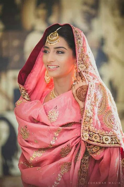 Wedding Hairstyles To Suit Dress by Traditional Indian Wearing Bridal Lehenga Jewellery
