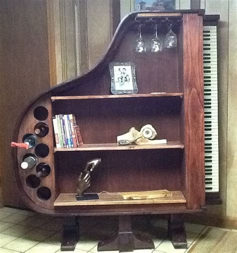 piano repurposed and bookcases on