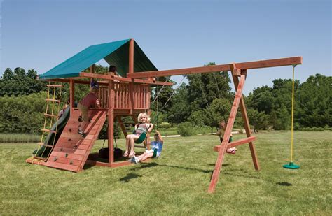 swing play three ring adventure wood swingsets with rock wall slide