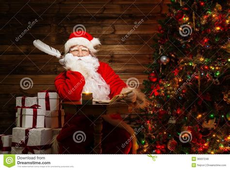 Santa Claus In House by Santa Claus In Home Interior Royalty Free Stock Photos