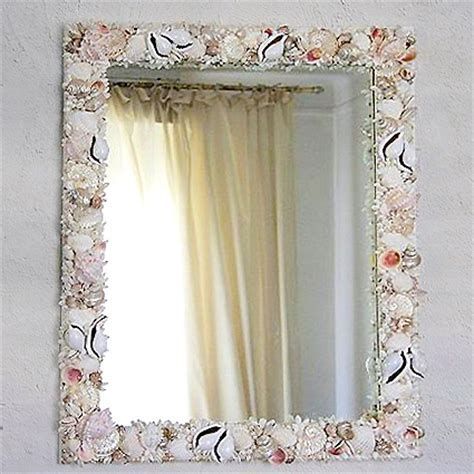 vasi con conchiglie specchio con conchiglie cristina vidolini creazioni in