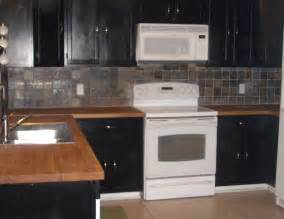 Black Wood Kitchen Cabinets Black Cabinets With Stainless Backsplash And Butcher Block Countertops Search