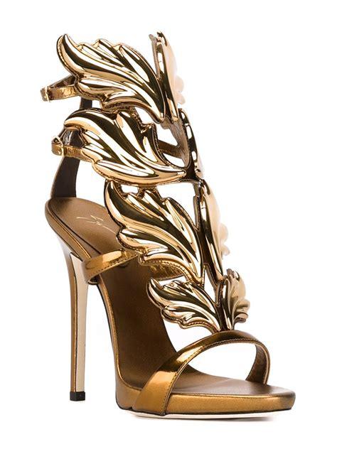 giuseppe zanotti gold sandals giuseppe zanotti leather wings sandals in gold metallic
