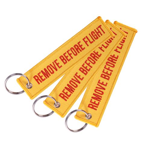 Kemeja Orange Preloved remove before flight key chain orange outger