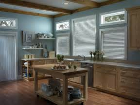 Pictured vinyl vertical blinds and faux wood blinds in kitchen