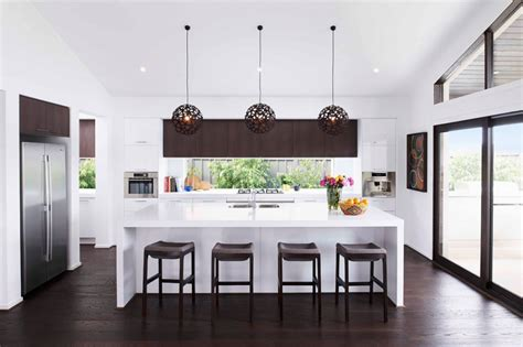 kitchen pendant lights and mirrored tile splashback home how to get your kitchen lighting right granite kitchen