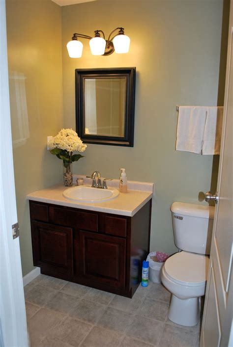 Half Bathroom Tile Ideas This Bathroom Mint Green Walls Brown Vanity W White Counter And Beige Grey Tile Floors