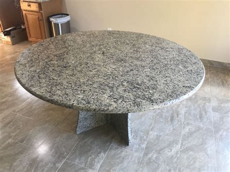 typhone boaurdoux exotic granite table with granite bases granite table hesano brothers