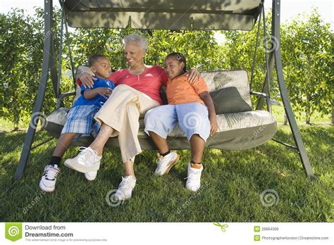 swing woman woman with grandchildren sitting on swing chair royalty