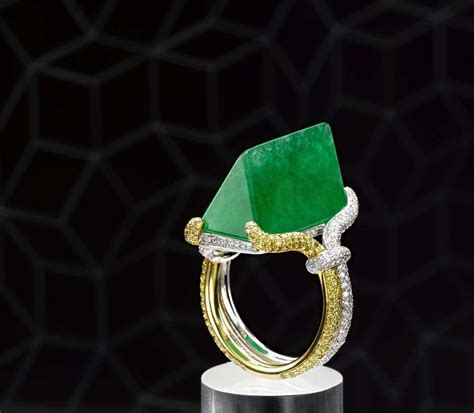 Kung Souvenir Rok Pendek Bermotif Yellow a polished rock of green jadeite set in a yellow and white