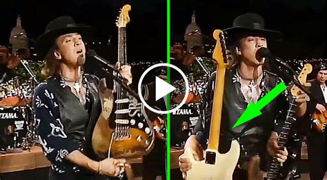 stevie ray vaughan pulls   smoothes guitar switch   stage  closely society