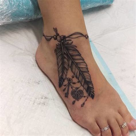 feather tattoo on foot meaning tattoos with meaning 69 popular tattoos with their meaning