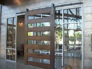 This 7 wide by 10 tall custom made wood barn door is in this atrium