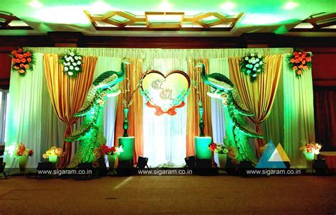 Peacock themed Engagement Stage decoration at Hotel