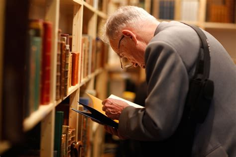 seniors and elders embrace books preventing dementia studying and computer