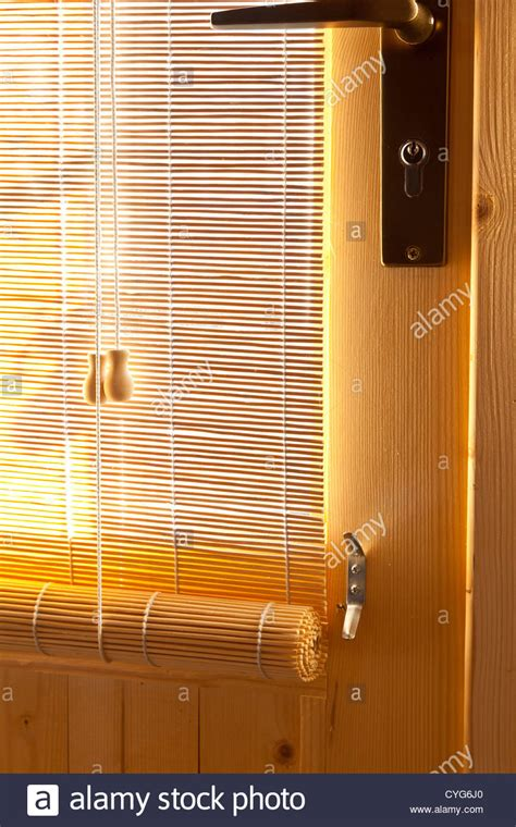 door window sun shades bamboo roller blinds sun shades on wooden door of garden