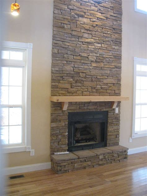 stone fire place fabulous floor to ceiling stacked stone fireplace design