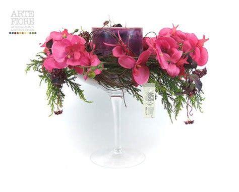 composizione di candele composizione floreale fiori artificiali in tessuto