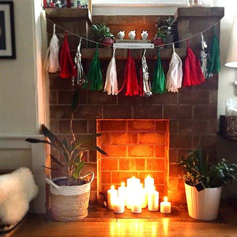 fill a fireplace with candles 39 clever home hacks for