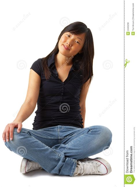 cute girl sitting cross legged stock photo image