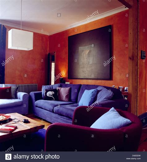terracotta sofa living room large abstract painting on wall above blue sofa in