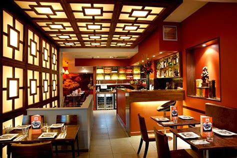 casual restaurant interior design with wooden furniture and bold wall painting ideas