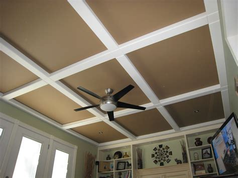 cover up popcorn ceiling hubby got this idea from a magazine panels and beams of