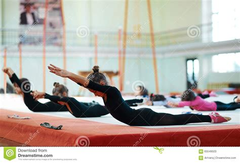 rhythmic swing girls swing back in training gymnastics stock photo