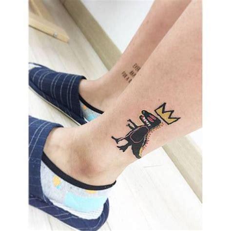 jean michel basquiats iconic t rex tattoo tattoo artist