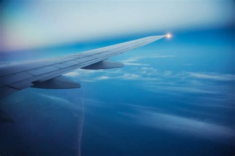 plane airplane airliner passenger sky clouds flight wing