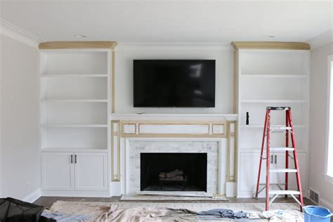 fireplace with built ins white built ins around the fireplace before and after