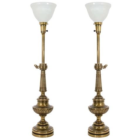 stiffel brass candlestick l pair stiffel neoclassical brass and ivory lacquered