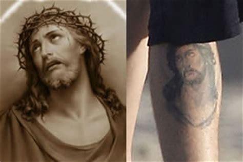 justin tattoo jesus jesus tattoo on justin bieber s leg