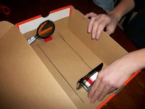how to make a diy home theater projector and 50 quot screen homemade iphone projector puts shoeboxes to good use pcworld