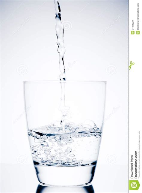 What To Fill Glass With Begin Filling A Glass With Water And Bubbles Stock