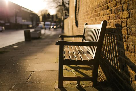 bench city brown wooden bench on the side of the road 183 free stock photo