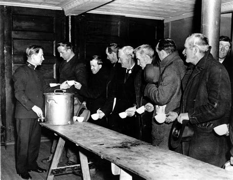 a salvation army relief worker tends to a line at a soup